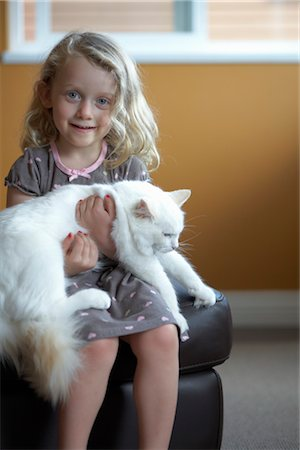 Young little girl petting pussy